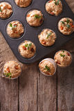 Muffins with ham and cheese in baking dish. vertical top view Royalty Free Stock Photo