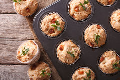 Muffins with ham and cheese close up in baking dish. horizontal Royalty Free Stock Image
