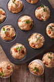 Muffins with ham and cheese close up in baking dish. vertical to Royalty Free Stock Image