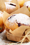 Muffins with jam sprinkled with powdered sugar Royalty Free Stock Image