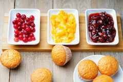 Muffins and jam. In a white dishes Stock Photos