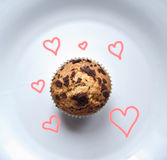 Muffins with love. Chocolate and blueberry flavored muffins Royalty Free Stock Photography