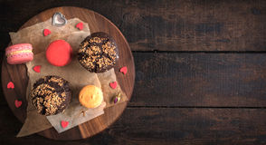 Muffins and macaroons Stock Image