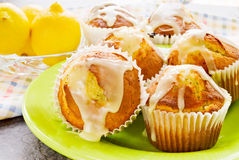 Muffins. Made with lemon and poppy seed. Icing dripping off the hot bread Royalty Free Stock Image