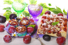Muffins and marble cake with plums and almonds Stock Photography
