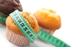 Muffins with measuring tape Royalty Free Stock Image