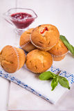Muffins with mint. Some fresh hot muffins with green mint in studio Stock Photos