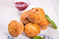 Muffins with mint. Some fresh hot muffins with green mint in studio Royalty Free Stock Photo
