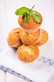 Muffins with mint. Some fresh hot muffins with green mint in studio Stock Photography