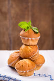 Muffins with mint. Some fresh hot muffins with green mint in studio Royalty Free Stock Images
