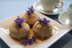 Muffins mit ganache Stockfoto