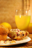 Muffins and orange juice Stock Photography