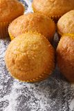 Muffins orange macro on floured table. vertical top view Royalty Free Stock Photos