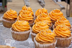 Muffins with orange mousse Royalty Free Stock Images
