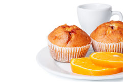 Muffins and orange slices Royalty Free Stock Photography