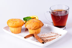 Muffins with orange and tea Stock Photos
