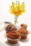 Muffins and orchids Royalty Free Stock Image
