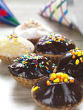 Muffins for a party. Two raws of homemade muffins decorated for a party royalty free stock photo