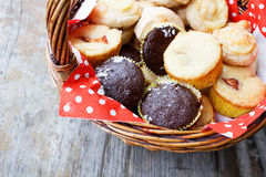 Muffins in picnic basket Royalty Free Stock Image