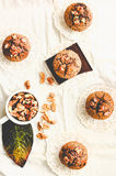 Muffins with pieces of dark chocolate and walnut,top view,tintin Stock Photos