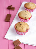 Muffins. In the pink table and chocolate stock images