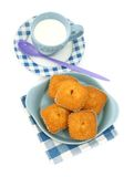 Muffins on plate and a the cup of milk isolated on Royalty Free Stock Images