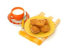 Muffins on plate and a the cup of milk isolated on Royalty Free Stock Photography