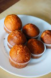 Muffins on plate Stock Photos