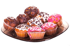 Muffins on a plate on white isolated Royalty Free Stock Photos
