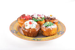 Muffins on plate isolated on white Royalty Free Stock Image