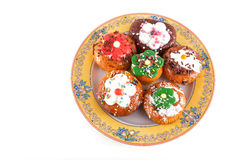 Muffins on plate isolated on white Stock Images