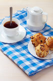 Muffins on plate, jug of milk Royalty Free Stock Photography