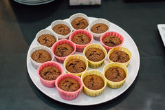 Muffins on a plate pastry bag people. Delicious muffins on a platen pastry bag people Stock Photos