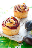 Muffins with plums royalty free stock images