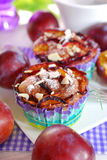 Muffins with plums and almonds Stock Photography
