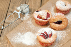 Muffins with plums Stock Images