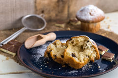 Muffins powdered by sugar on white blue plate and natural backgr Stock Images