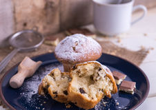 Muffins powdered by sugar on white blue plate and natural backgr Stock Image