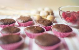 Muffins with raspberries Stock Photos