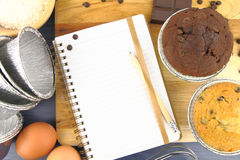 Muffins recipe. Blank recipe book with muffins on the table Stock Image
