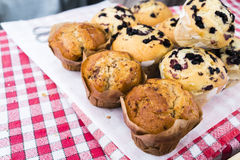 Muffins on red checked cloth in French market in Paris France. Royalty Free Stock Image