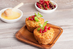 Muffins with red currant, decorated mint. Muffins with red currant, horizontal, close up Stock Photos