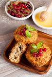 Muffins with red currant, decorated mint. Muffins with red currant, vertical, close up Royalty Free Stock Photos