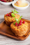 Muffins with red currant, decorated mint. Muffins with red currant, vertical, close up Stock Images