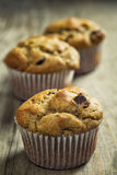 Muffins on rustic farm table. Banana nut, chocolate chip muffins on rustic farm table Royalty Free Stock Photo