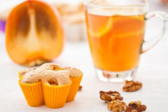 Muffins with slices of persimmon Royalty Free Stock Image