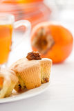 Muffins with slices of persimmon Stock Photo