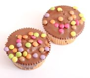 Muffins. Some fresh muffins with candies Royalty Free Stock Images