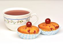Muffins with sour cherries and tea Stock Photo