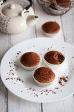 Muffins with spelt flour and cocoa on a table Stock Photo